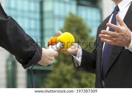 Interviewing businessman - stock photo
