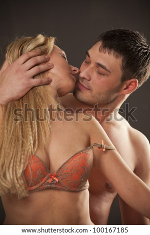 Intimate couple during foreplay on the bed