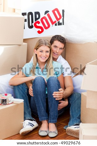 Intimate couple embracing after move in at home - stock photo