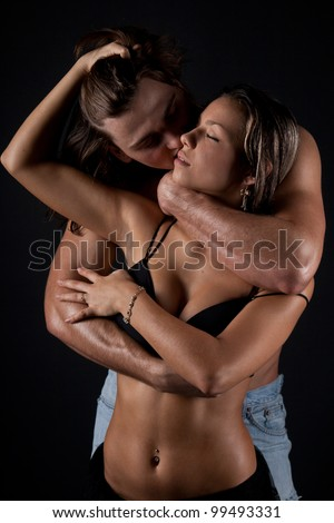 Intimate dark image of sensual couple foreplay - stock photo