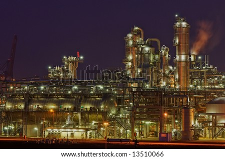 Intimate details of a chemical production facility at night - stock photo