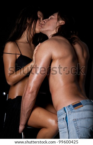 intimate image of sensual couple foreplay, kissing passionately - stock photo