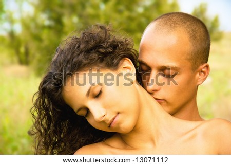 Intimate image of young happy sensual adult couple in love, sexy passionate brunette girl and athletic man