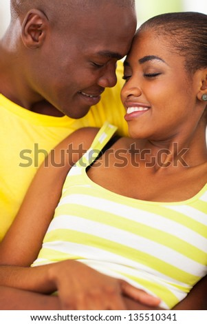intimate young african couple in love - stock photo