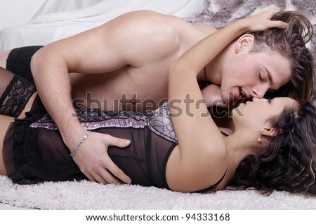 intimate young couple during - stock photo