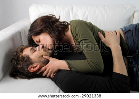 intimate young couple on a sofa - stock photo