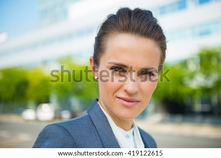 Into the ultra-modern business trends. Portrait of business woman in modern office district