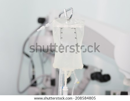Intravenous drip in operation room - stock photo