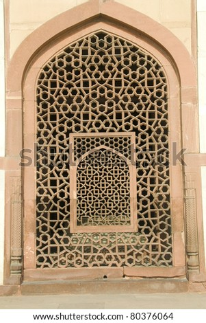 Intricate carving of stone window grill at Humayun's Tomb, New Delhi, India, Asia