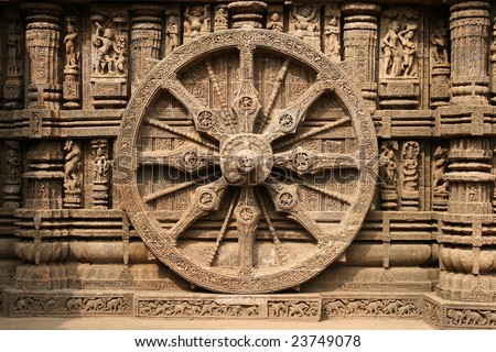 Intricate carvings on a stone wheel in the ancient Surya Hindu Temple at Konark, Orissa, India. 13th Century AD - stock photo