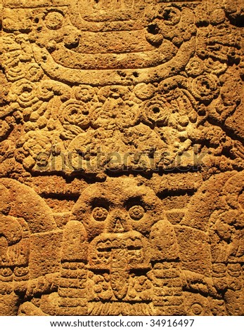 Intricate carvings on stone made by the ancient Aztec(s) of Tenochtitlan, Mexico. - stock photo