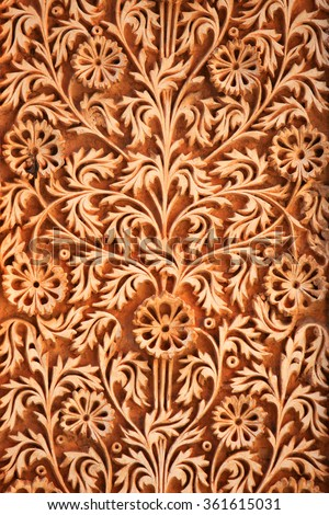Intricate design carved on the walls of historic Paigah tombs in Hyderabad, Rajasthani and deccan style architecture - stock photo