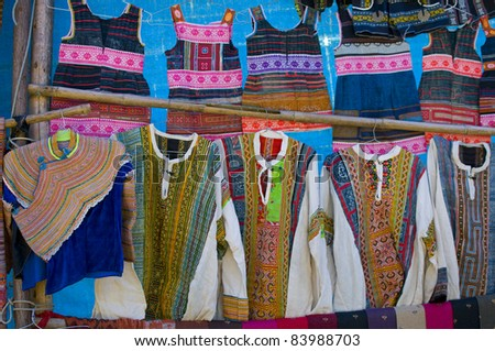 Intricate flower  hmong indigenous tribe colorful dress in Bac Ha market, Vietnam. - stock photo