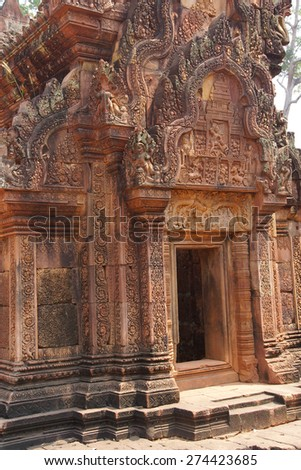 Intricate stone carving on red sandstone doorways and portals,  Banteay Srei, Cambodia - stock photo