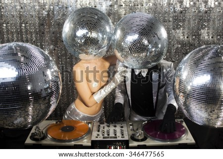 introducing mr and mrs discoball. two cool club characters DJ in a nightclub setting - stock photo