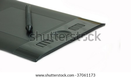 Intuos4 small size pen tablet with stilus isolated on white with copy-space. Angle view of tablet for painting.