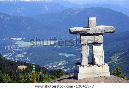 Inukshuk at Mt Whistler, Canada - stock photo
