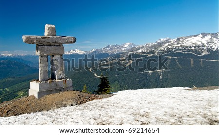 Inukshuk at the Roundhouse at Whistler, Canada. Stone landmarks used by the Inuit, Inupiat, Kalaallit, Yupik, and other peoples of North America - and were used for navigation & points of reference. - stock photo