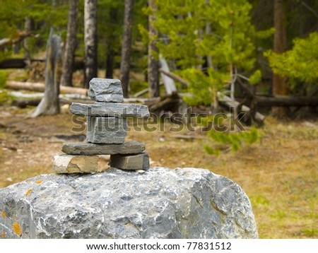 inukshuk from area Banff National Park, Alberta, Canada - stock photo
