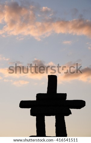 Inukshuk in sunset - stock photo