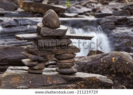 Inukshuk in Wilson Falls, Muskoka. - stock photo