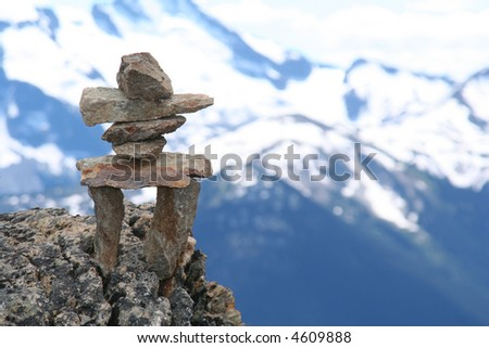 Inukshuk on top of Whistler mountain.  Symbol of the 2010 Winter Olympics to be held in Vancouver. - stock photo