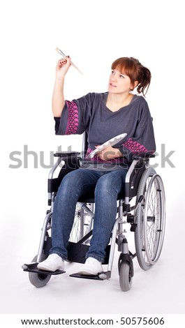invalid girl on wheelchair isolated on white - stock photo