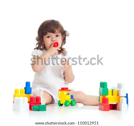inventive kid girl with construction set toy over white background