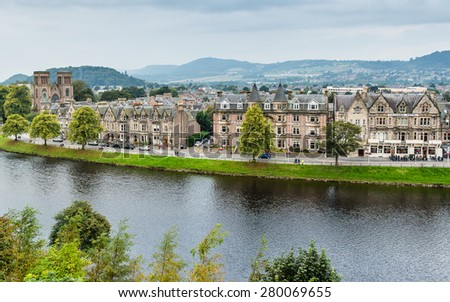 INVERNESS, SCOTLAND - SEPTEMBER 19, 2014: Ness Walk and Ardross Terrace waterfront river panorama from castle. The edwardian and victorian architecture of these hotels and guest houses is touristic.
