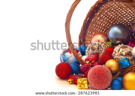 inverted basket with Christmas toys on a white background - stock photo