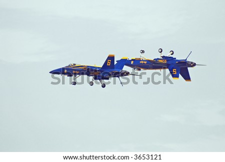 Inverted F-18 Navy Blue Angel Approaching Second Aircraft