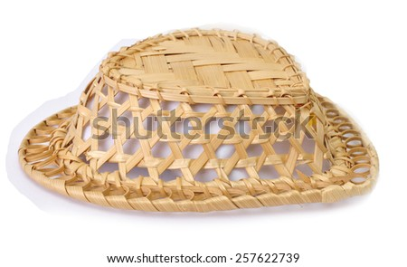 Inverted wicker basket isolated on white background