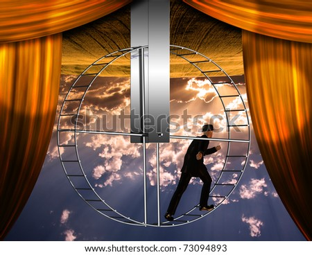 Inverted world and man on hamster wheeel - stock photo