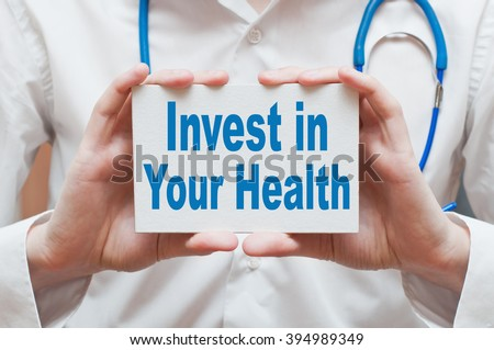 Invest In Your Health, medical concept. Physician shows information - stock photo