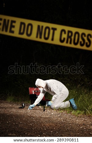 Investigation - collecting pistol and cartridges on forest way - stock photo