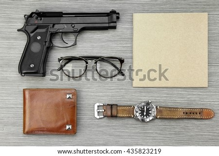 Investigation Concept. Private Detective Tools On The Woodden Background, Guns, Watch, Notebook, Wallet, Glasses. - stock photo