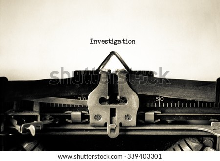 Investigation typed on a Vintage Typewriter.  - stock photo