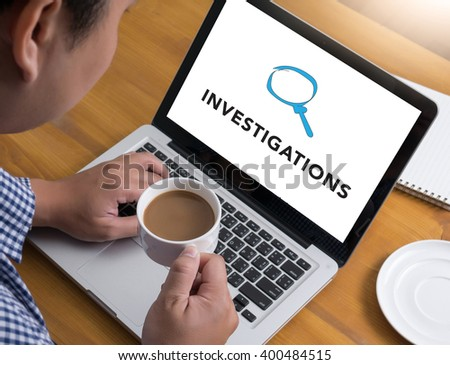 INVESTIGATIONS CONCEPT        Businessman at work. Close-up top view of man working on laptop while sitting at the wooden desk , coffee - stock photo