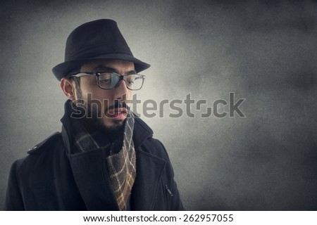 investigator, Man resembling a detective, Man in Winter Clothes .  - stock photo