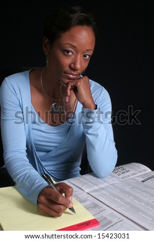 Investing for the future, lovely educated Black woman - stock photo