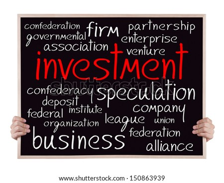 investment and other related words handwritten on blackboard with hands - stock photo