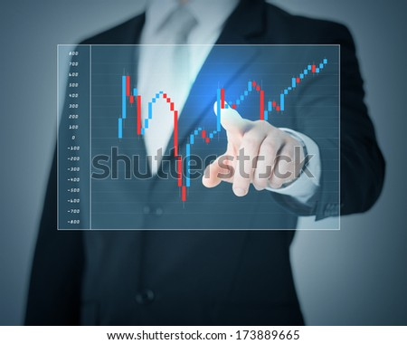 investment, business, future technology and money concept - closeup of man hand pointing at forex chart