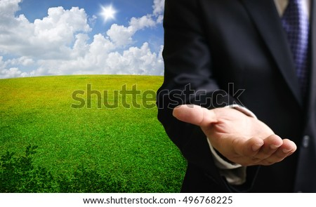 Investment concept, Businessmen show open hand with nice landscape background