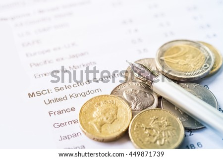 Investment concept. US. dollar, Euro money coins and pen place on the stock market information sheet.