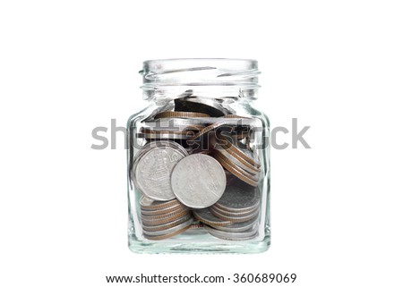 Investment growth concept,coins in clear jar over white background,saving money