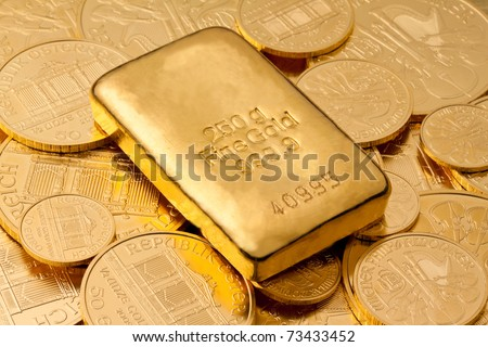 Investment in real gold than gold bullion and gold coins - stock photo