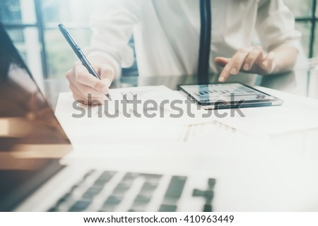 Investment manager work process.Photo business woman touchig modern tablet screen report.Statistics graphic screen.Banker  signs document,new startup,marketing plans.Horizontal,bokeh and film effects - stock photo