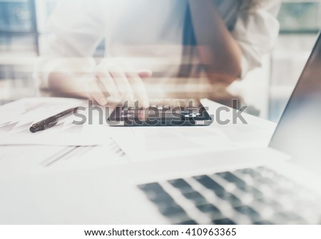 Investment manager working process.Photo business woman showing reports modern tablet screen.Statistics graphics screen.Banker ready for signs documents, new startup.Horizontal, bokeh and film effects - stock photo