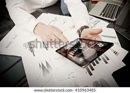 Investment manager working process.Photo trader work market report modern tablet.Using electronic device.Graphic icons,stock exchange reports screen.New business project startup.Horizontal,film effect - stock photo