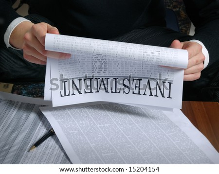 investment news on  newspaper page. financial marketing - stock photo